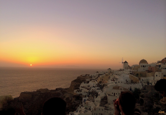 Greek Oia sunset windmill
