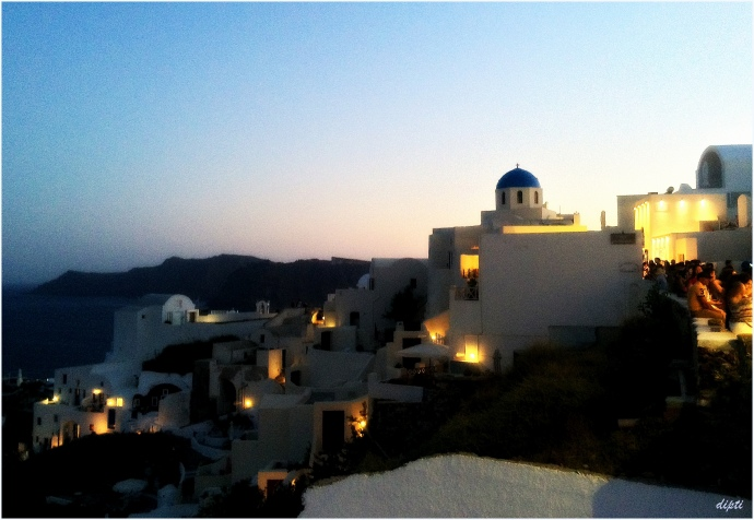 Oia sunset white blue house